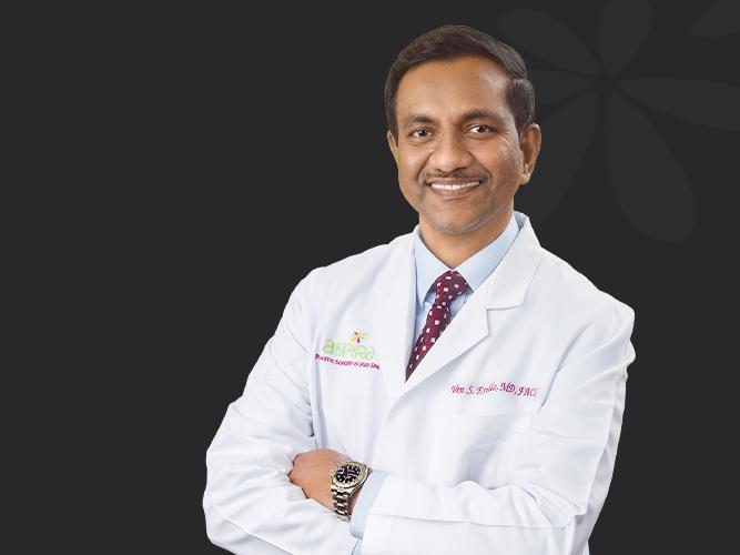 Dr. Erella posing with a smile