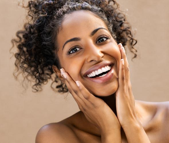 model smiling showing off skin