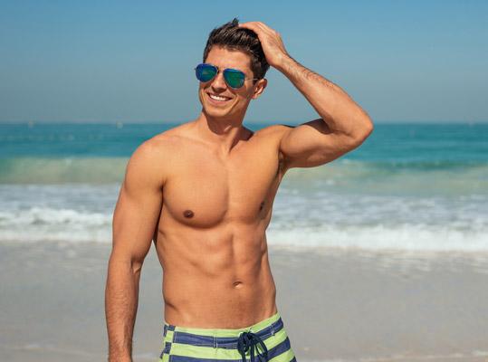 Male model shirtless smiling