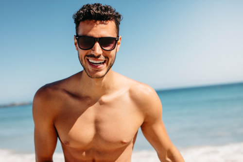 man smiling showing chest