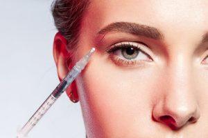 model receiving eyebrow injections