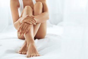 model holding legs sitting