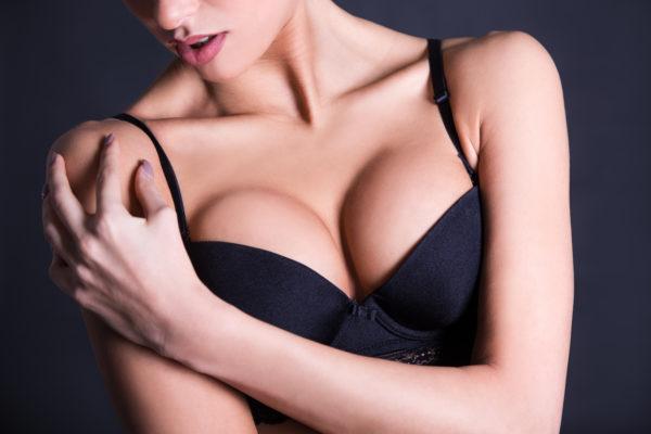 model posing showing bust