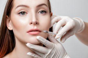 model receiving lip injections